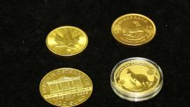 Złote monety, sztabki złota, złota biżuteria [przebitki]